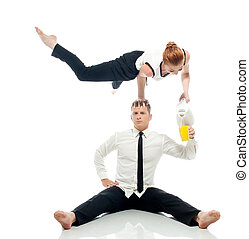 Concept of multi-tasking - businessmen-acrobats isolated on...