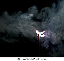 Burned match and smoke