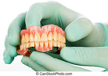 Dentist 's hands and dental product - Dentist holding two...