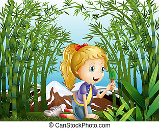 A girl with a green shovel kneeling in the rainforest -...