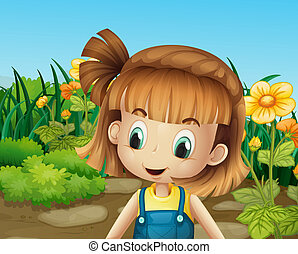 A cute little girl in the garden with blooming flowers