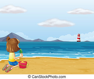 A young girl playing with the sand in the beach -...