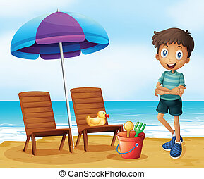 A young boy at the beach near the wooden chairs