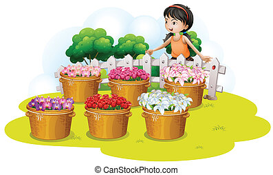 A girl looking at the flowers in the basket