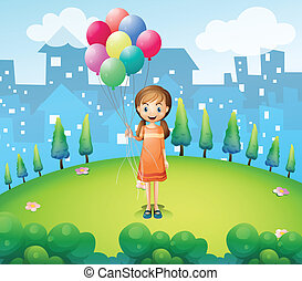 A girl holding balloons in the city