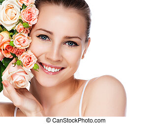 smiling woman blond with roses - portrait of attractive...
