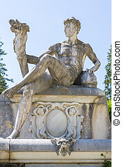 Allegoric stone male statue