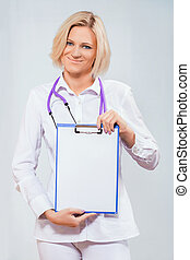 female doctor holding a clipboard