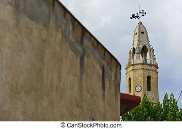 Summer view of church tower in Catalonia, Creixell, Spain