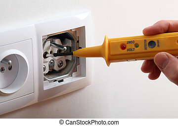 Voltage in socket - Checking voltage with detector in power...