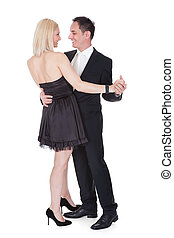 Couple In Formal Attire Dancing