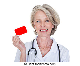 Mature Female Doctor Holding Visiting Card Over White...