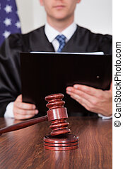 Male Judge In Courtroom - Male Judge With The Gavel And Book...