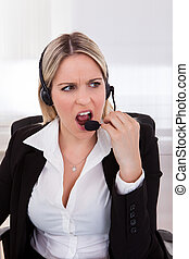 Woman Operator With headset - Close-up Of Young woman...