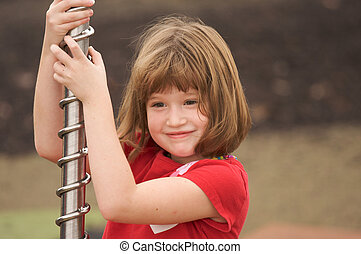 Adorable Young Girl at the playground
