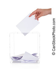 Closeup Of Hand Inserting Ballot In Box Over White...