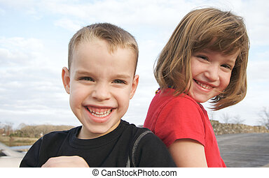 Two Children Smile for the Camera