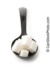 Sugar in a spoon over white background - Sugar in a spoon...