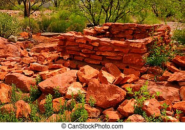 Stone Ruins - old falling down red stone house ruins