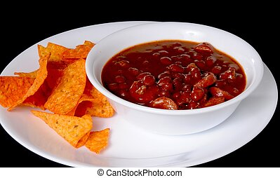 Chili with meat hotdogs and chips isolated on black