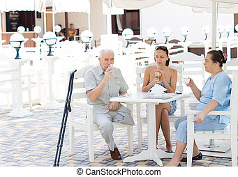 Family enjoying a drink together
