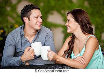 First date at a coffee shop - Pretty young couple having fun...