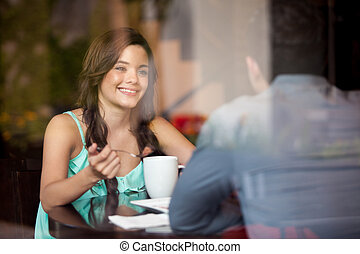 Enjoying coffee with my date - Cute young woman drinking...