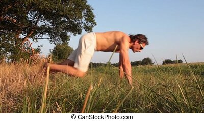 push ups - Young man doing exercises in the forest