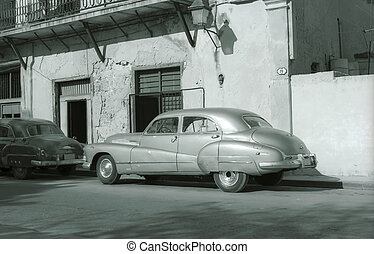 Old cars in Cuba - Old American vintage car on a street in...