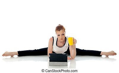 Concept of multi-tasking - Gymnast working on PC isolated on...