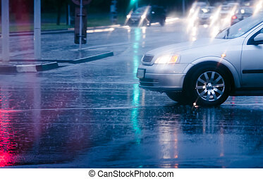 Car on wet road - Looking through car window in the rain