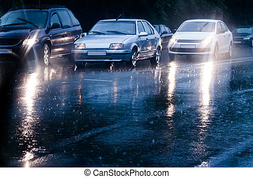 Rainy evening - Traffic jam in flooded street
