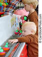 Children Playing Carnival Duck Game - Two children, a baby...
