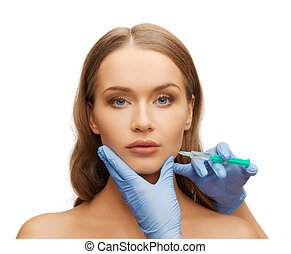 woman face and beautician hands with syringe - cosmetic...