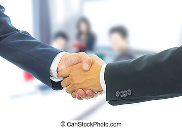 business man shaking hands with business people background