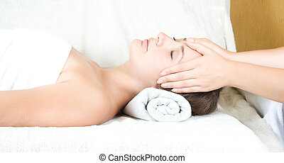 Massage Therapy - Female receiving massage therapy on face