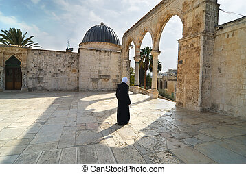 By the Dome of the rock - Muslim woman by the mosque the...