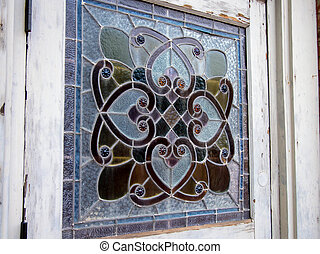 Stained Glass Detail - An old time stained glass panel set...