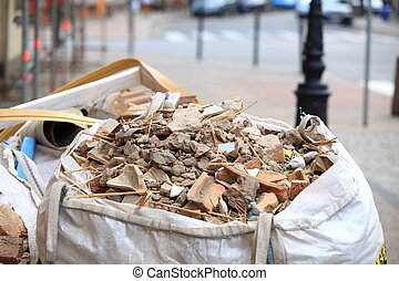 Full construction waste debris bags, garbage bricks and...