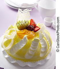 fruits cake - yellow color cake with fruits decoration