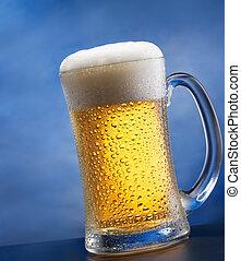 mug of beer against blue background