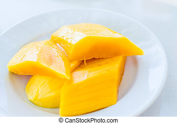 4 sliced mango pieces - Fruit 4 sliced mango pieces on a...
