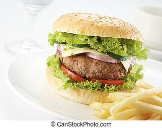 burger with restaurant serving - burger served with fries on...