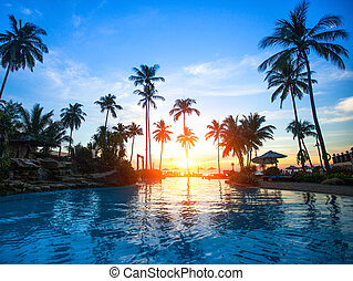 Beautiful sunset at a beach resort in tropics