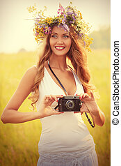 old camera - Portrait of a romantic smiling young woman in a...