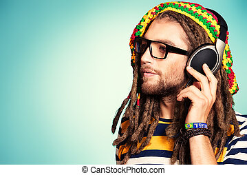 rasta music - Portrait of a happy rastafarian young man...