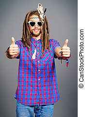 love peace - Portrait of a hippie young man showing thumbs
