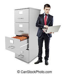 business man with laptop standing near a 3d file cabinet, on white background