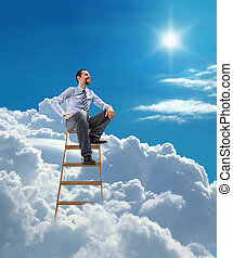 businessman sits atop at the ladder - young man in shirt and...