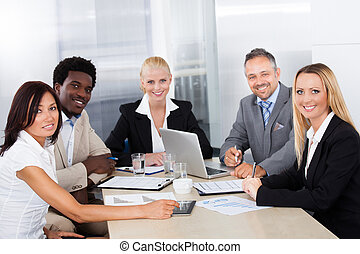 Group Of Businesspeople Discussing Together - Group Of Multi...
